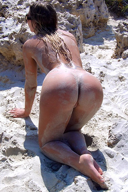 Getting Dirty Nude On The Beach